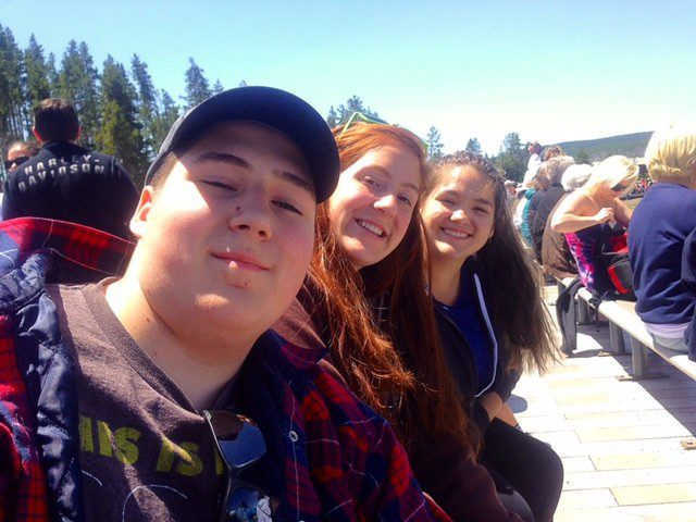 My Kids at Old Faithful in Yellowstone Waiting For it to Erupt